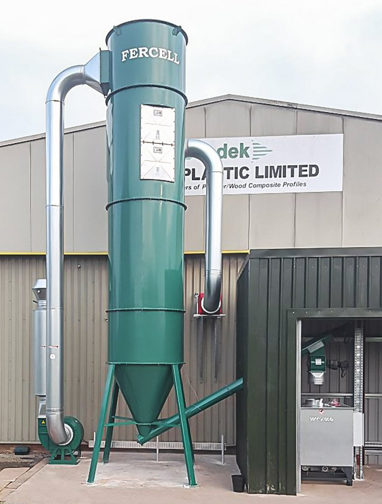 Absaug- und Filteranlage neben einer WEIMA C 140 Brikettierpresse