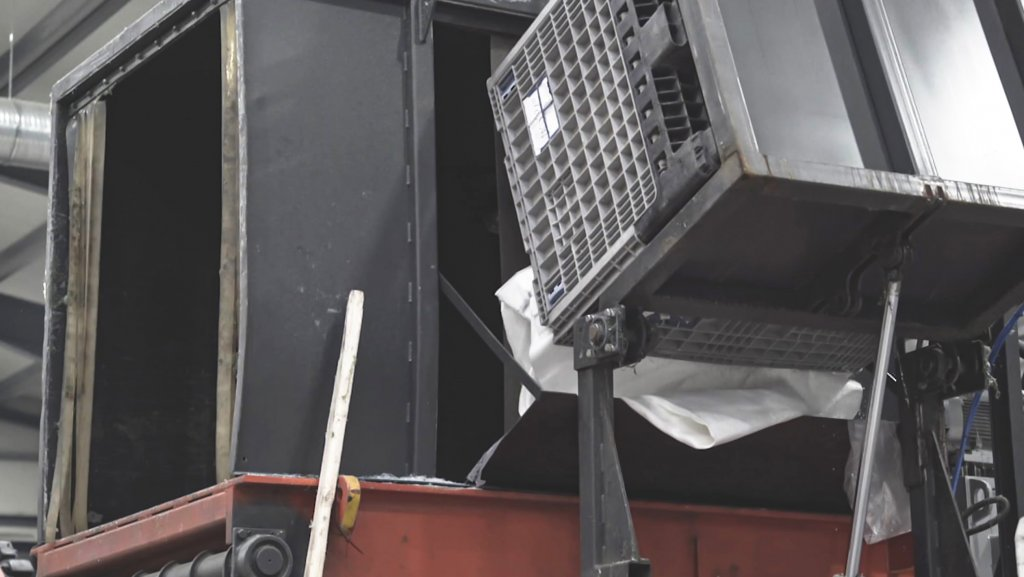 Plastic is fed into the hopper via a tilting system