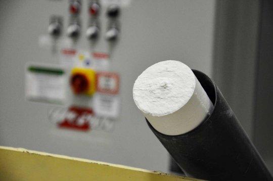Paper filter dust briquette