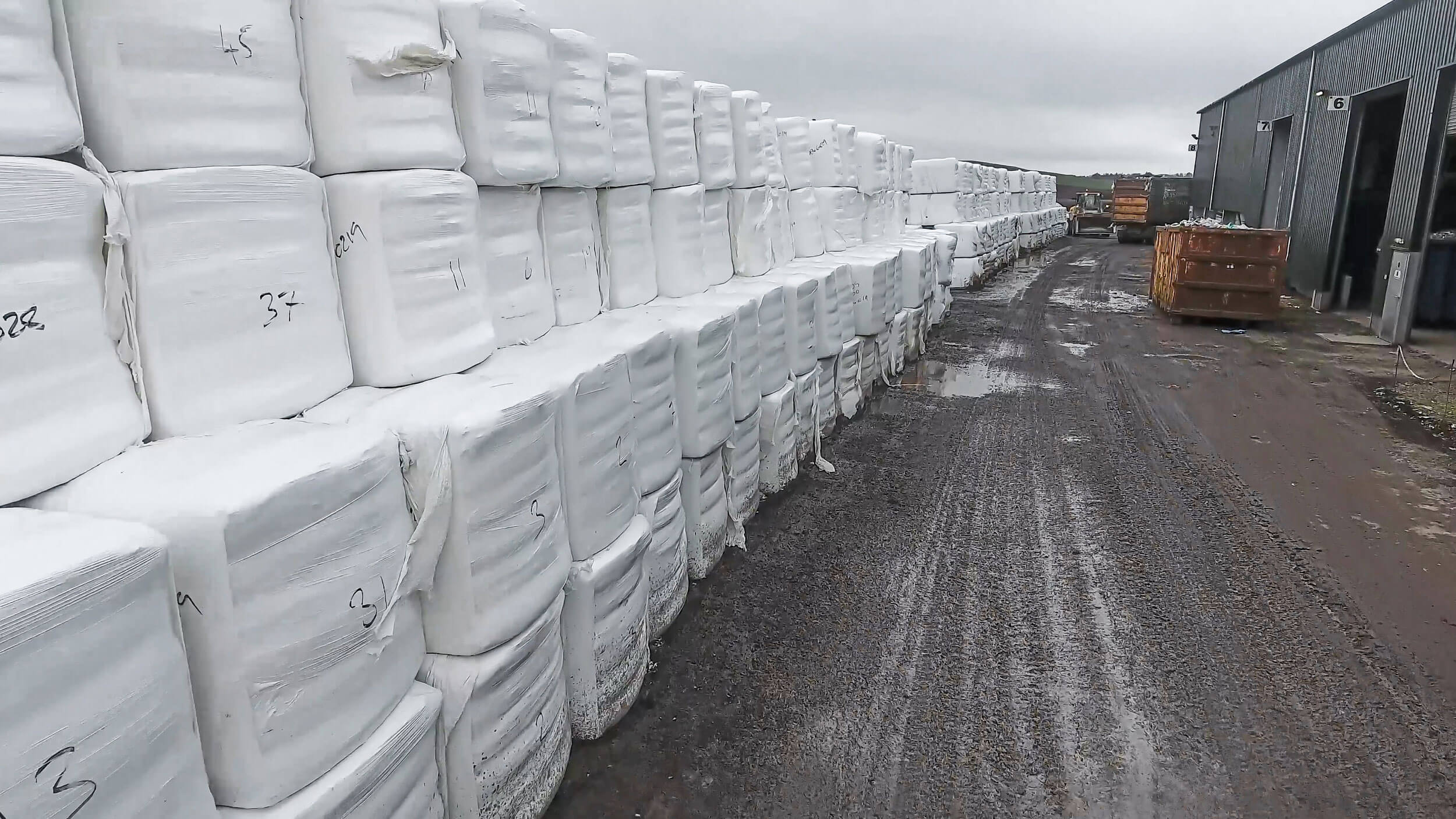 The bales of SRF are stored outside.