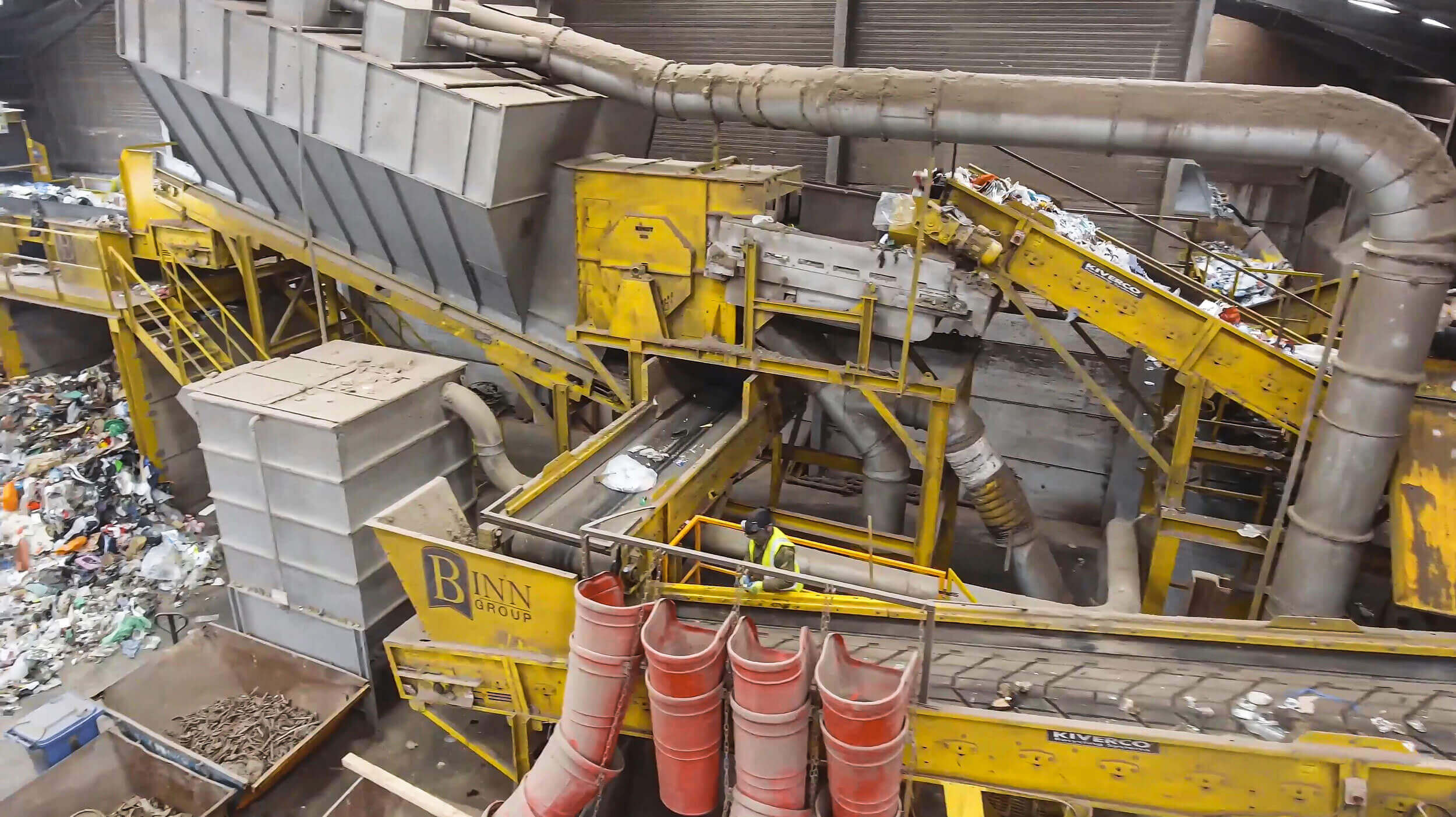 The conveyor belt system transports materials that were screened by the wind sifter to the picking station.