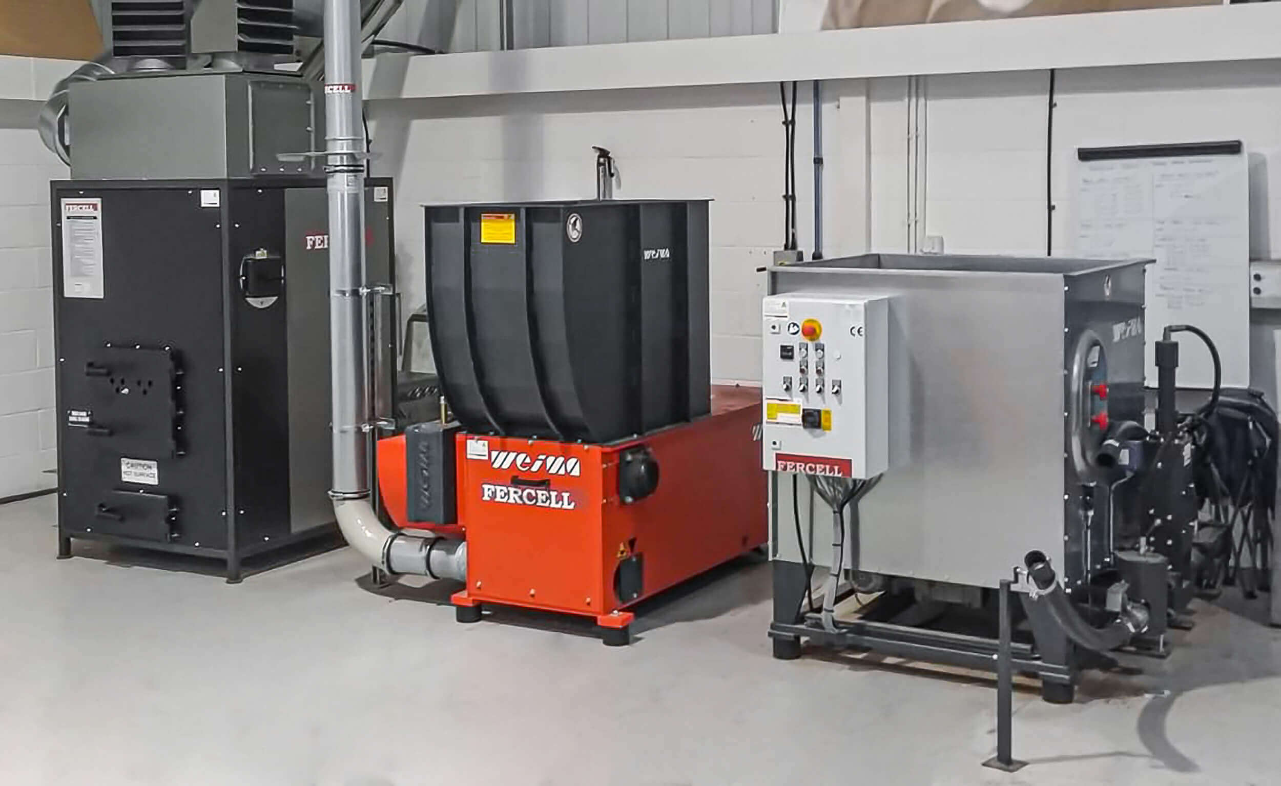 The WEIMA dream team for disposal of wood waste: WL 4 and C 140 with a wood-burning oven
