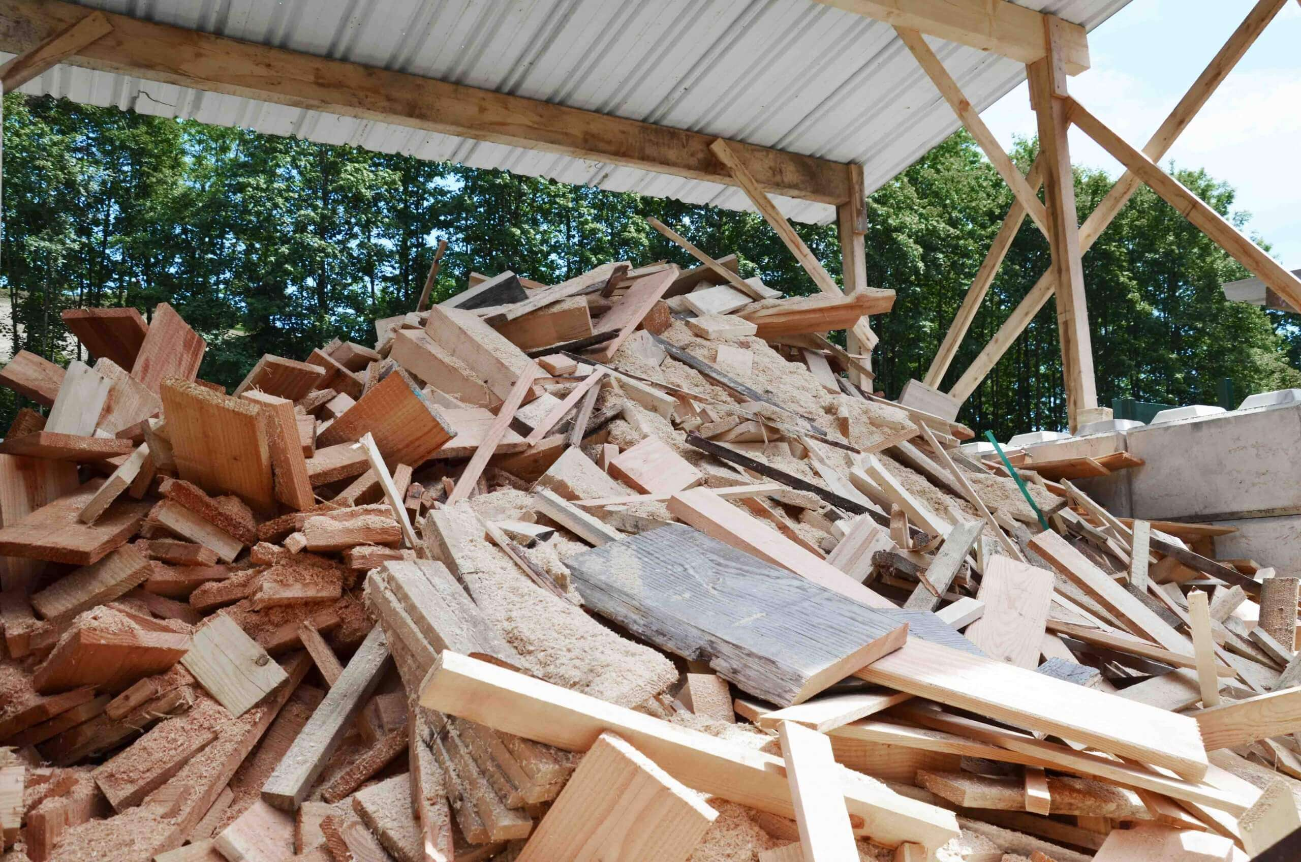 A pile of demolition wood before the shredding process
