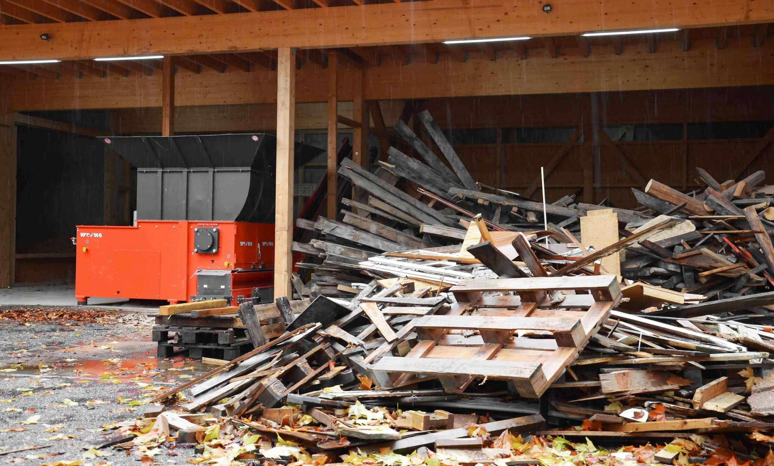 Wood waste beside WEIMA shredder
