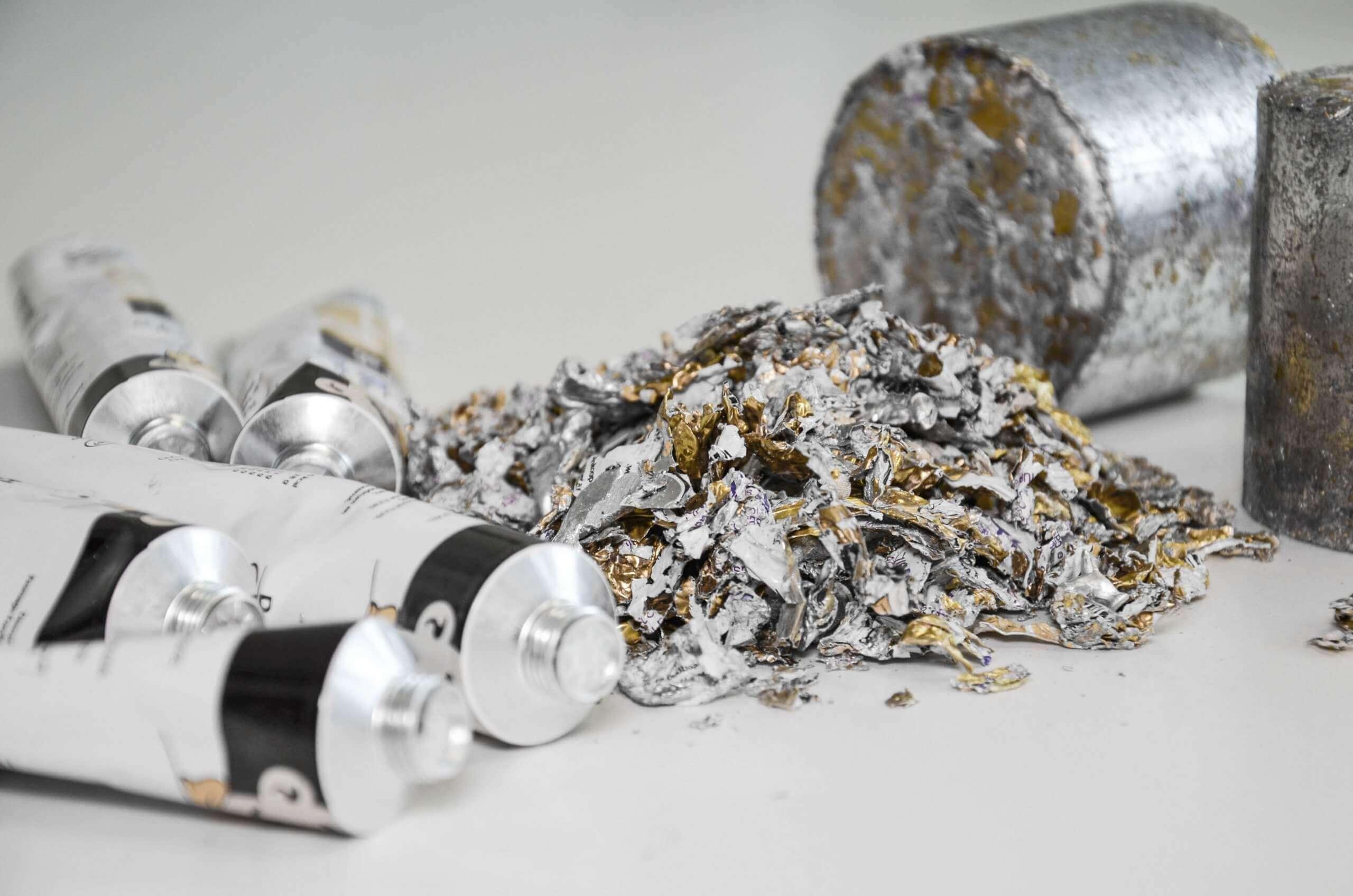 Aluminum tubes, shredded aluminium and aluminium briquettes