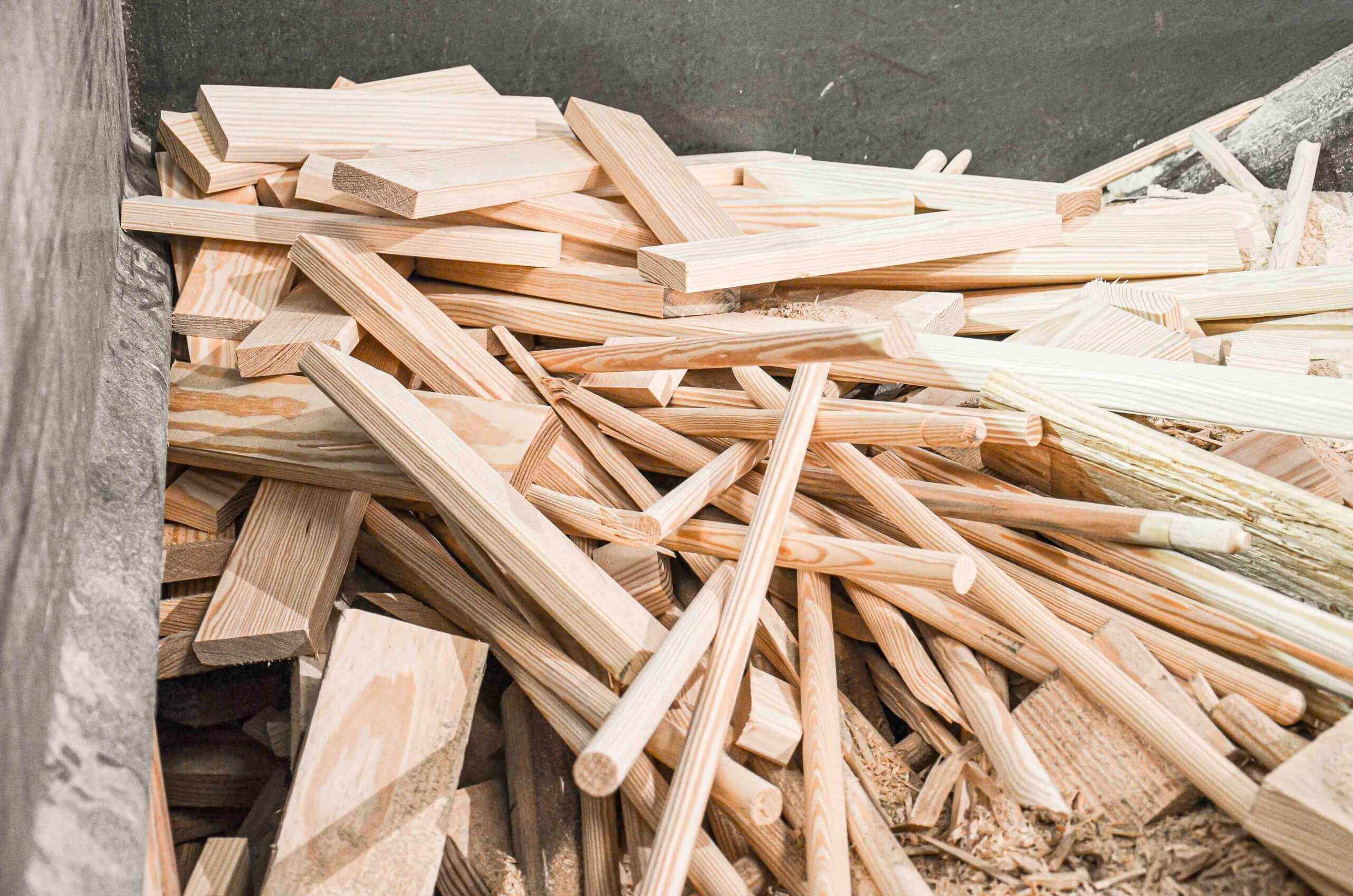 Wood scrap like broom handles and other wood waste