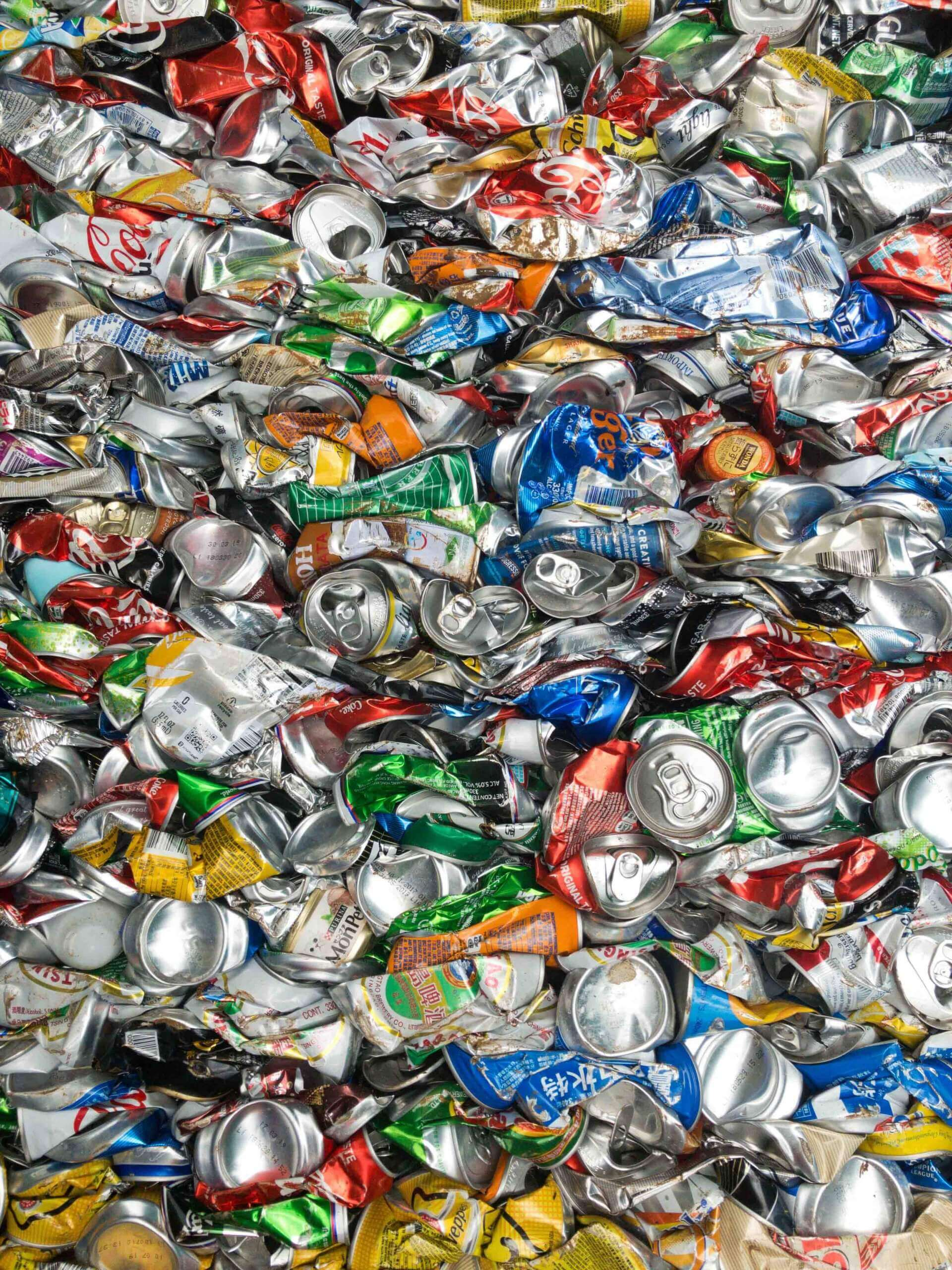 Compressed aluminum cans for recycling