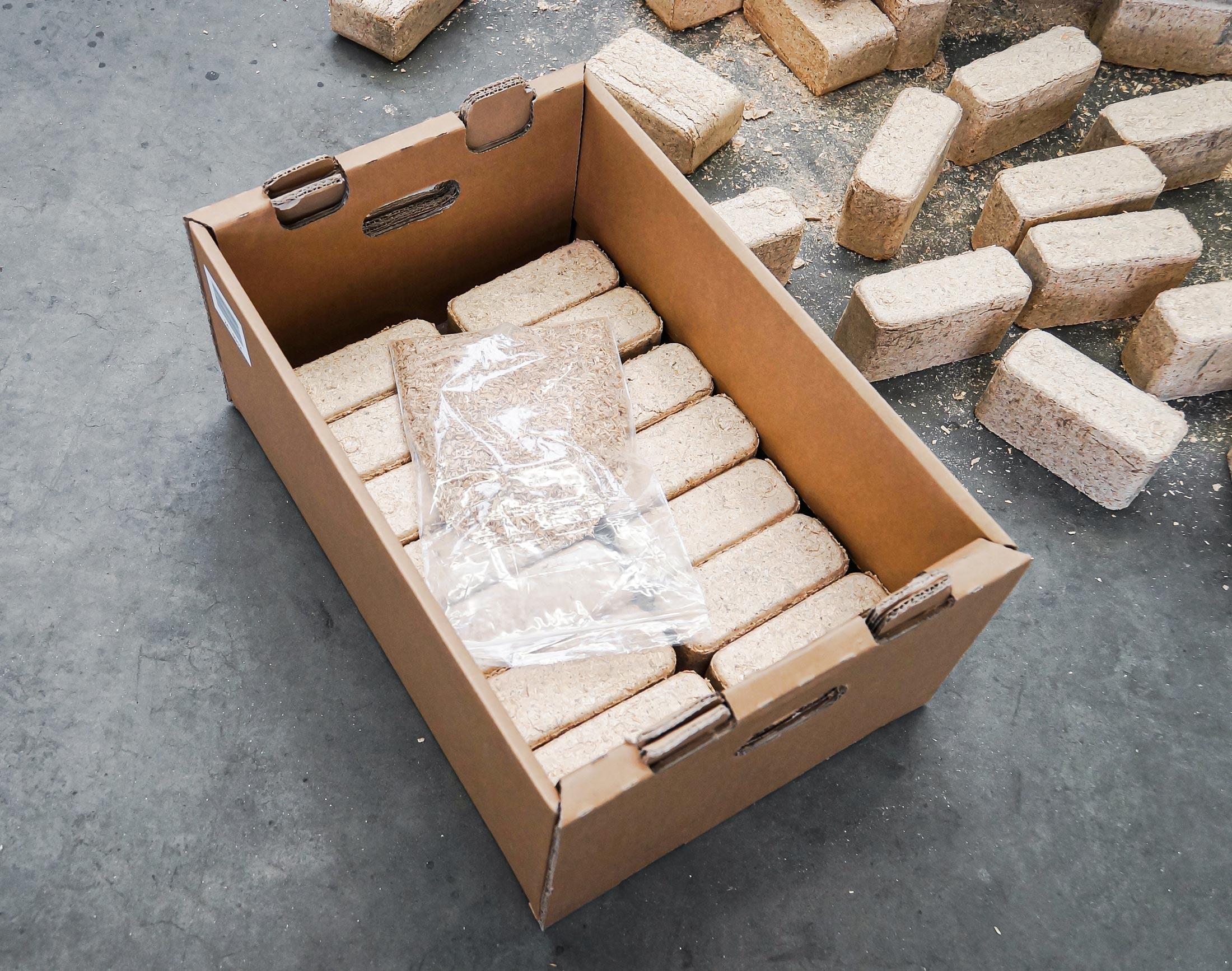 Rectangular hardwood briquettes are prepared for shipment