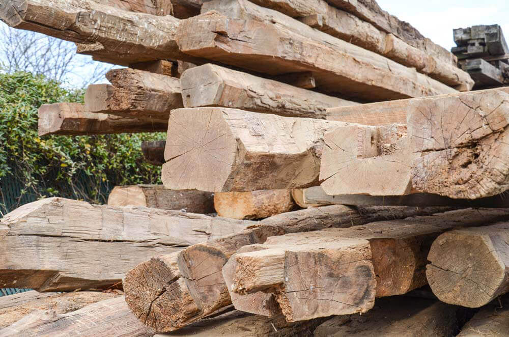 Stacked wood waste such as wooden beams