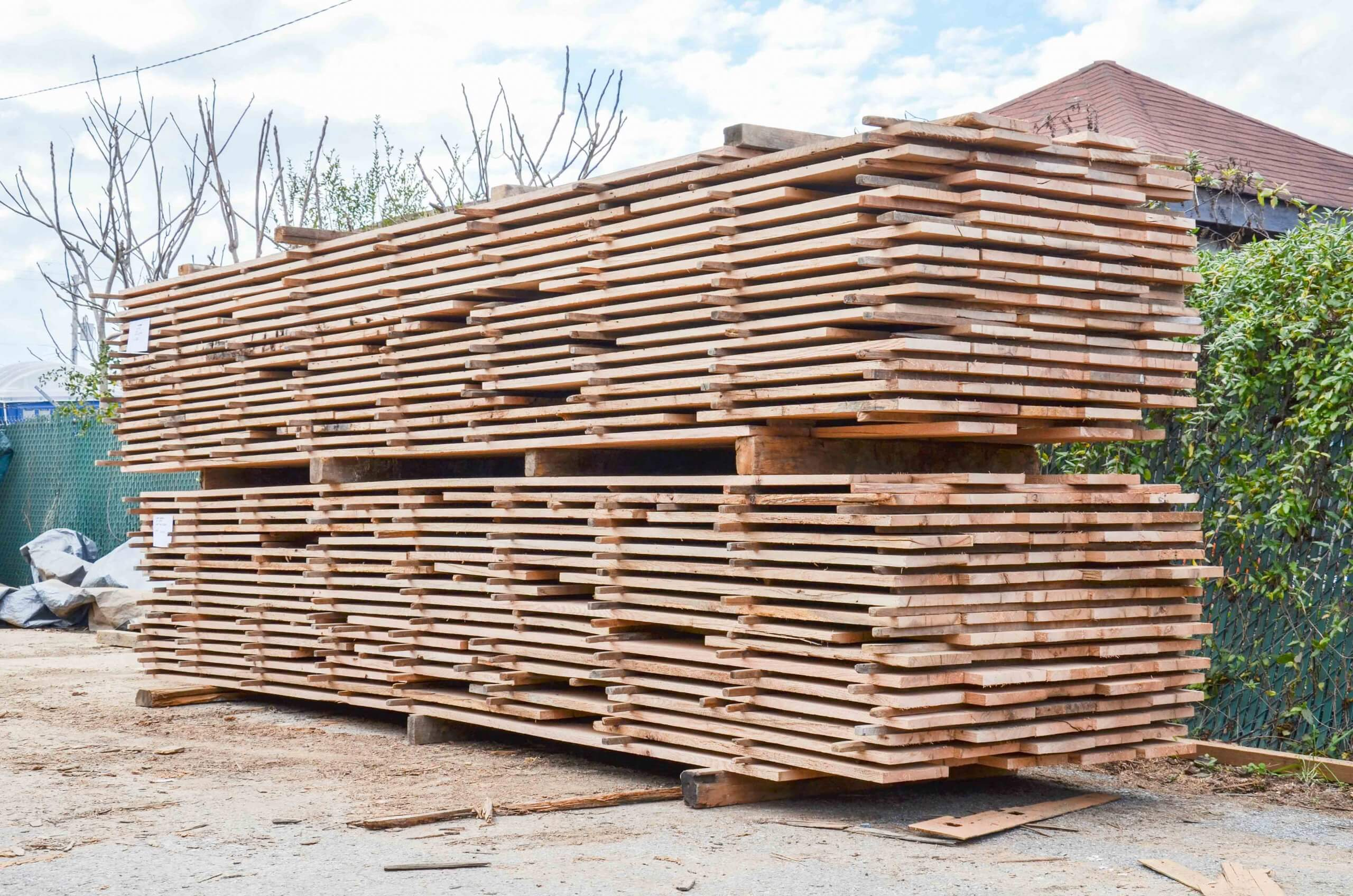 Stack with wooden planks before shredding with WEIMA machinery
