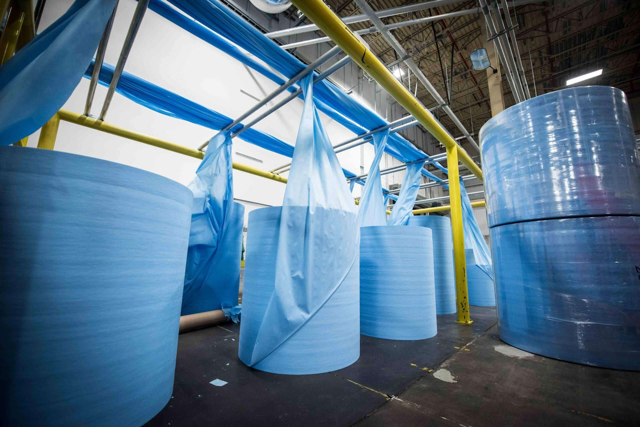 Production waste from hygienic textile production is shredded and returned to the production process