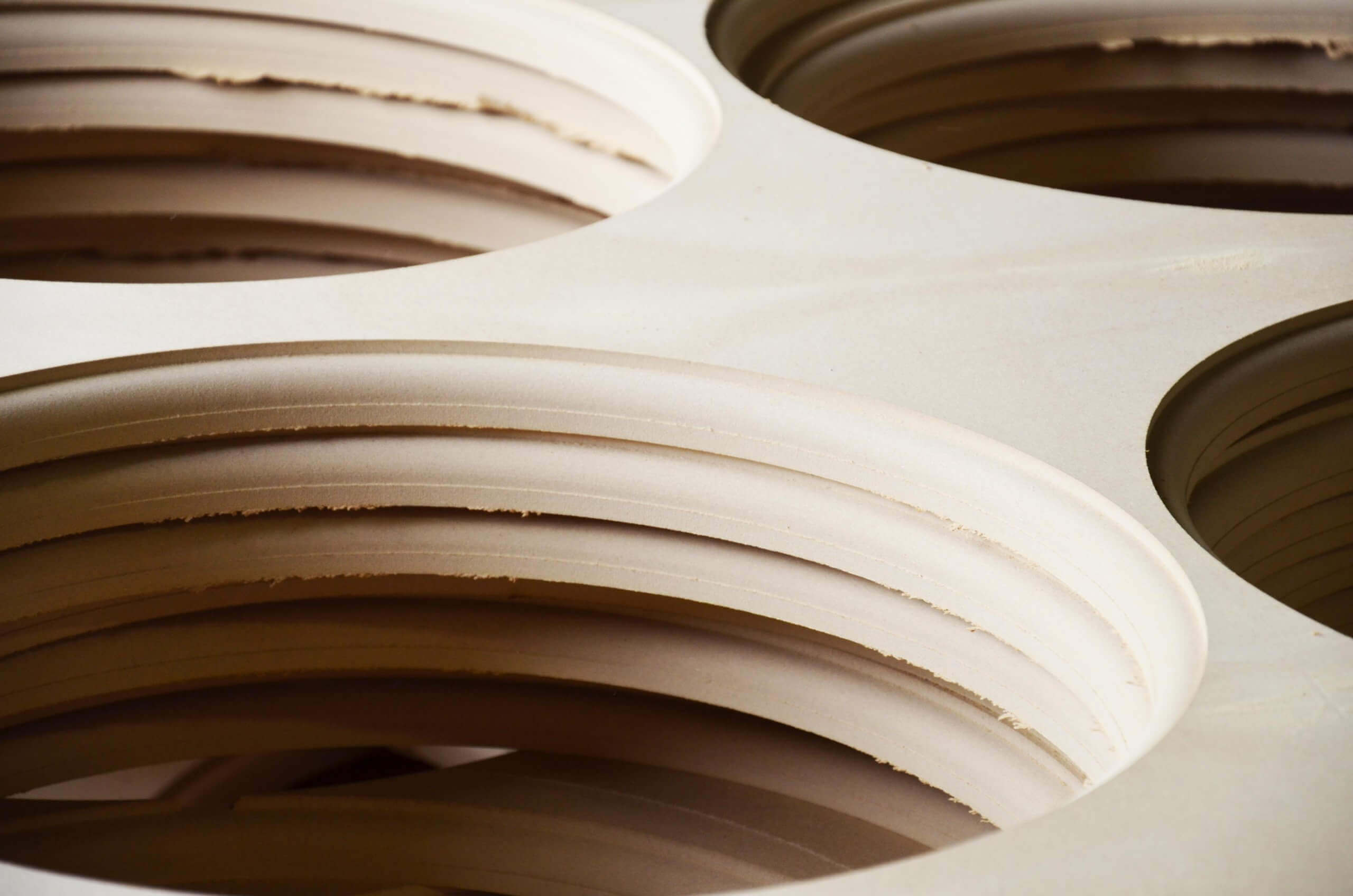 Wood scrap like MDF boards with punched holes