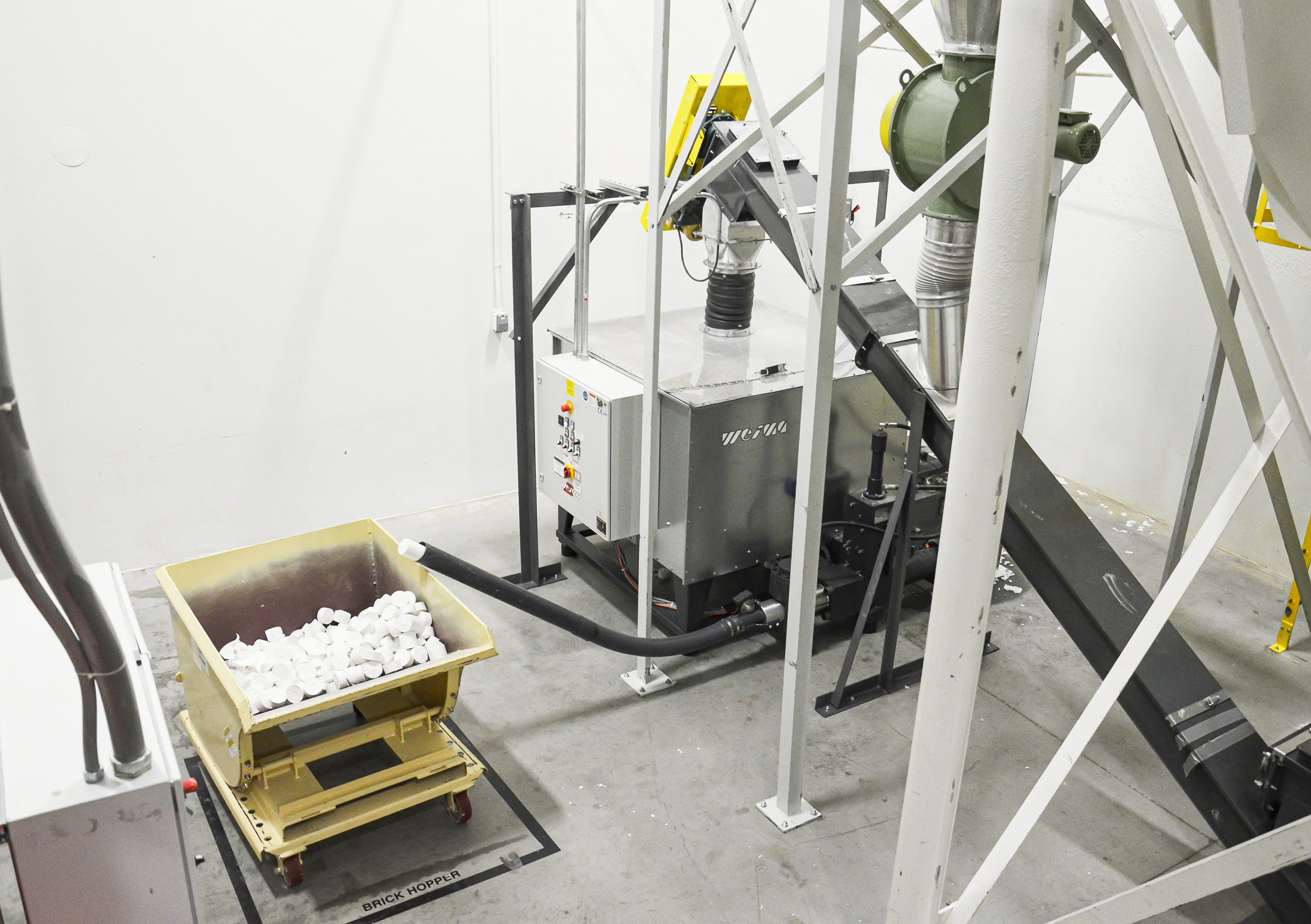 Briquetting of paper filter dust