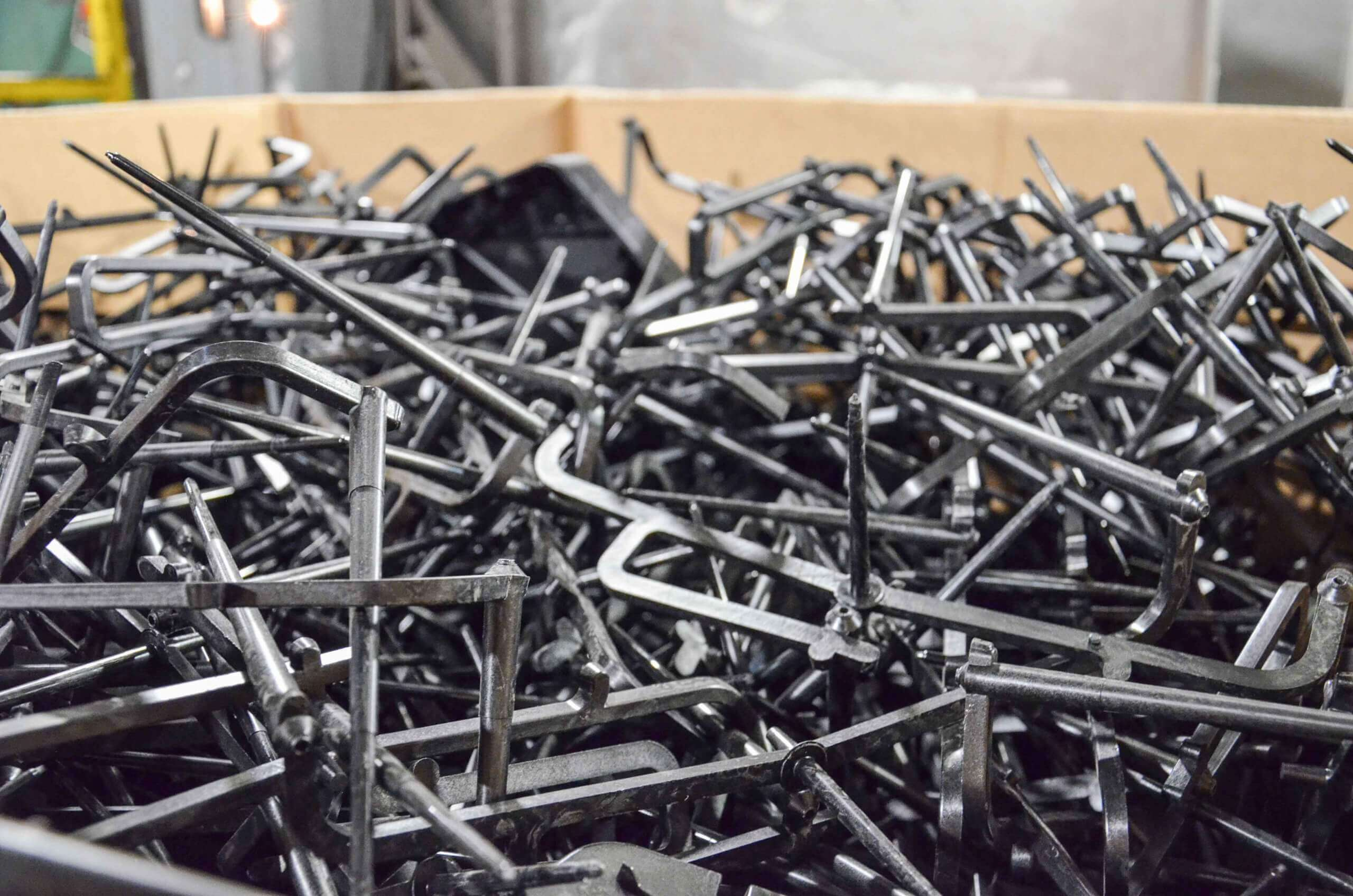 Injection moulding waste is stored in boxes until shredding