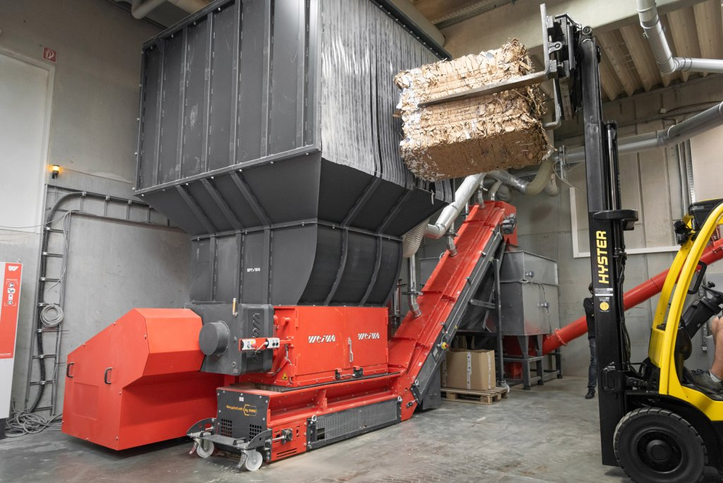 The WEIMA shredder is filled by forklift.