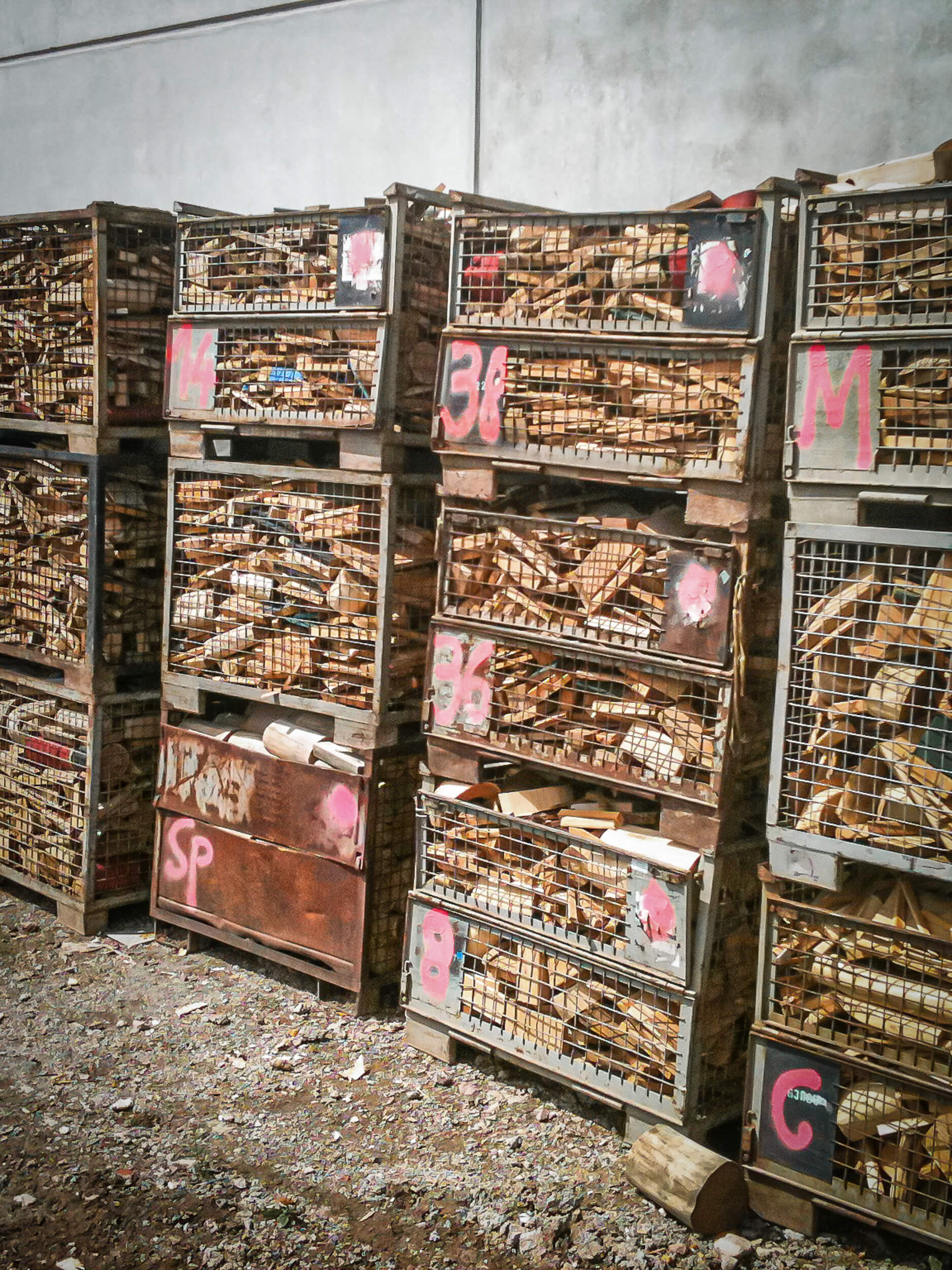 Wood scrap is kept in towers of lattice boxes before the shredding process