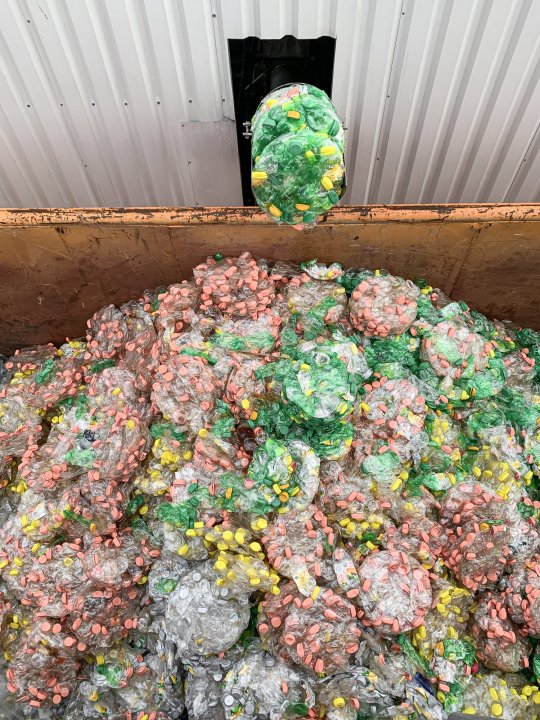 PET bottles are dewatered and compacted with PUEHLER press