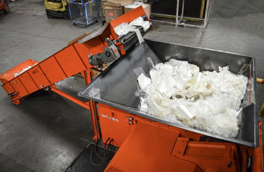 Shredder is filled with conveyor belt system