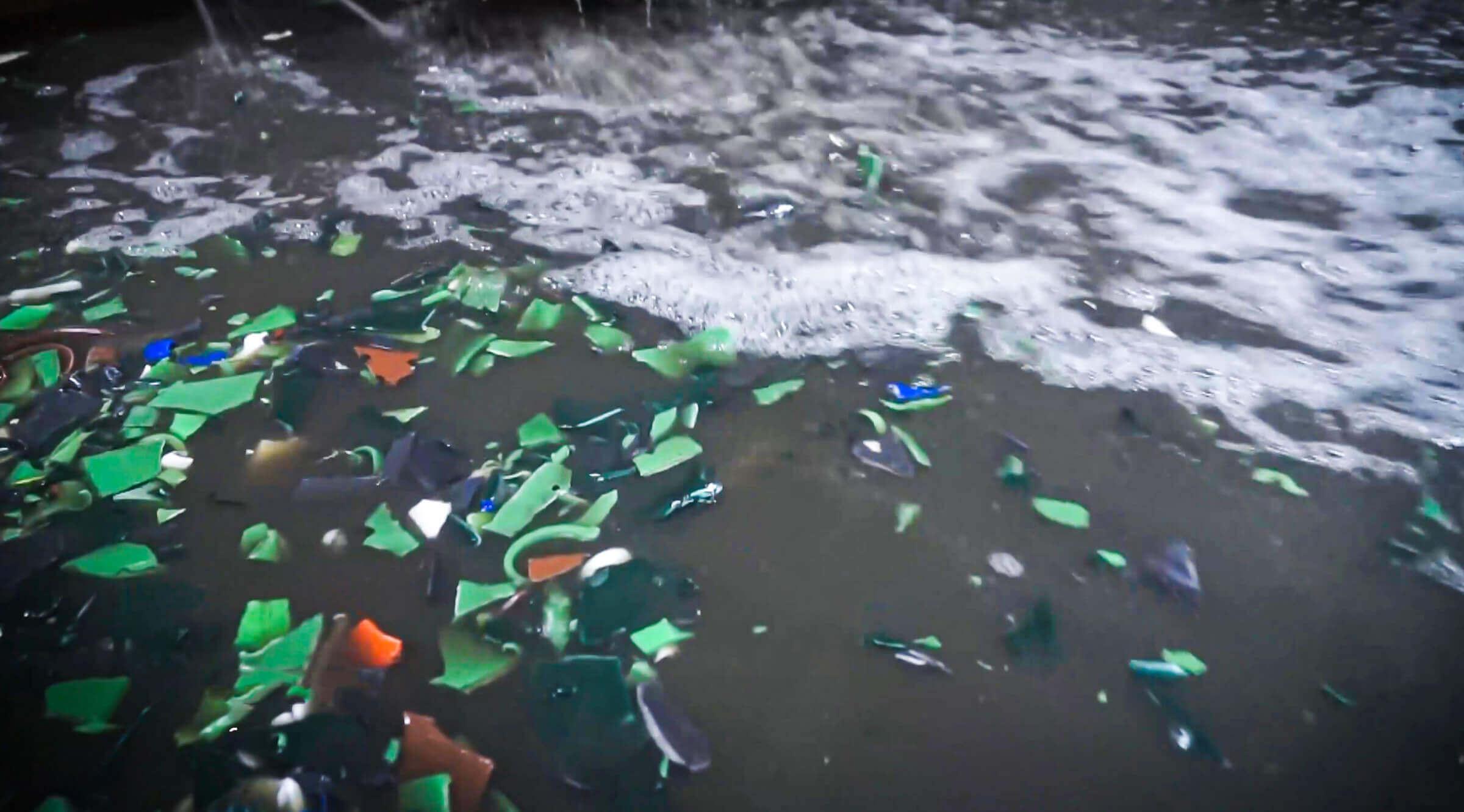 Washing of the shredded plastic
