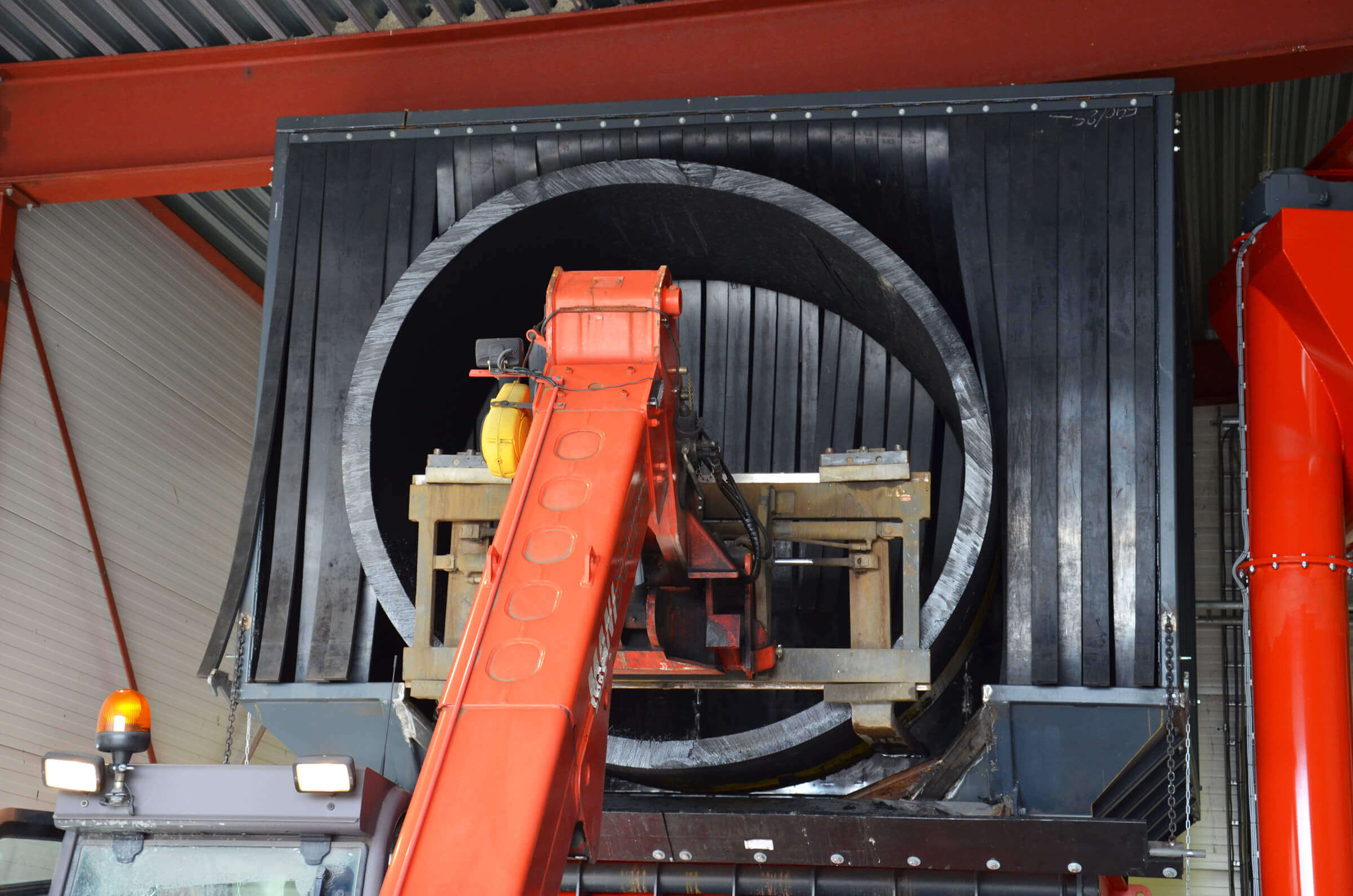 2.5 diameter pipe cuttings are loaded into the WEIMA shredder