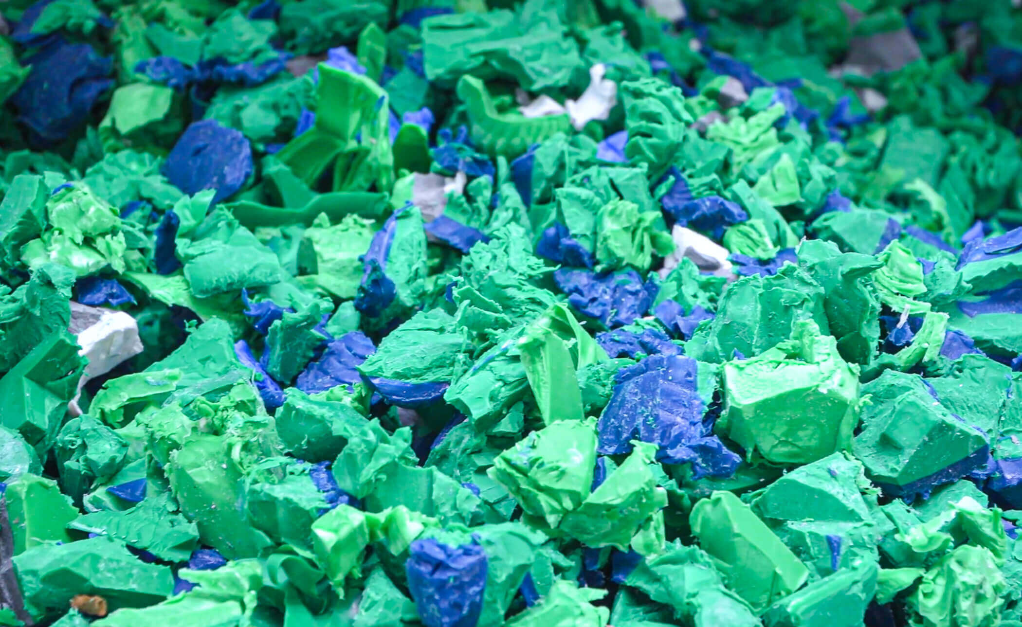 Plastic flakes form HDPE pipe shredding