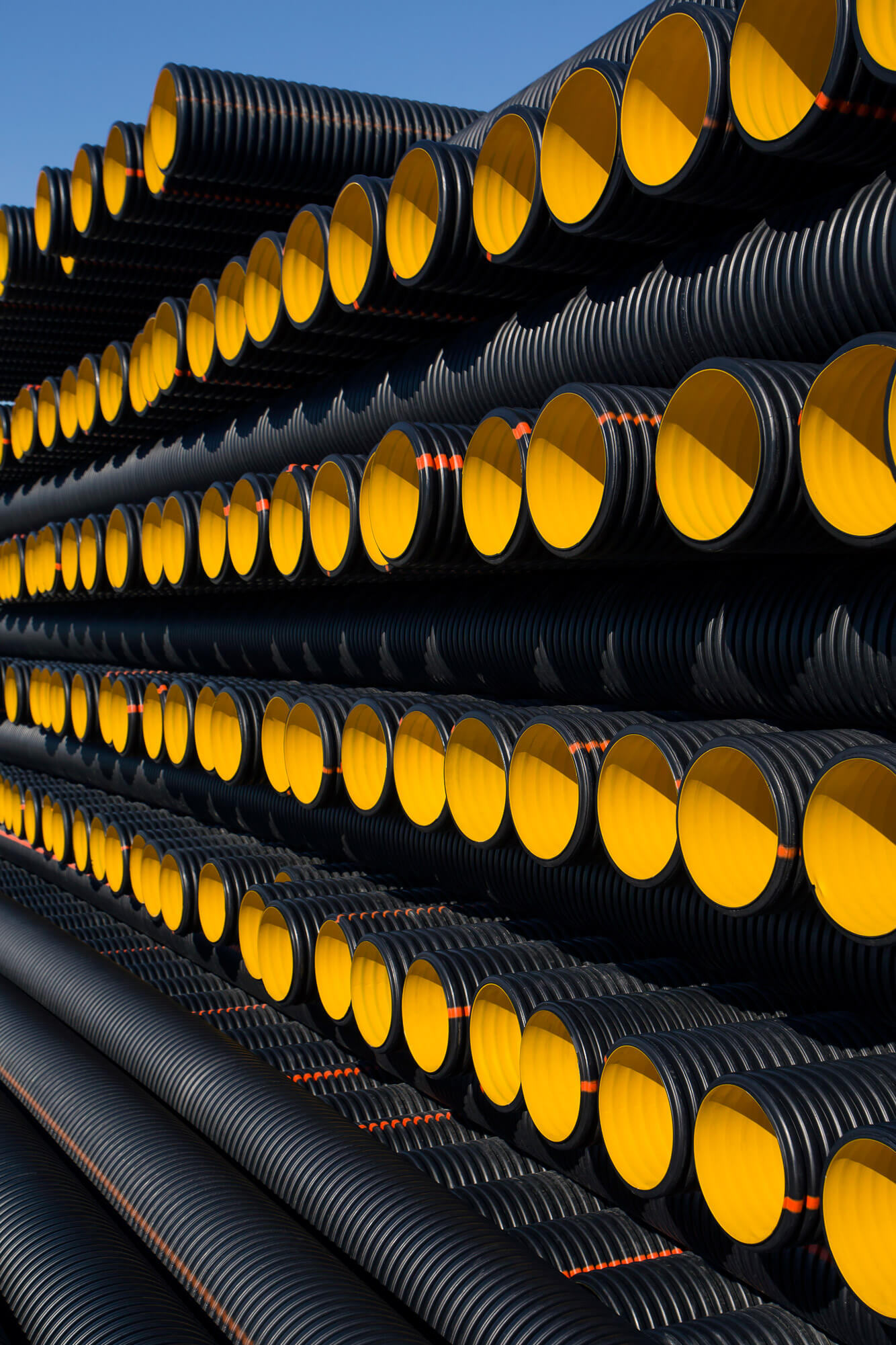 Polyvinyl chloride pipes are stored stacked