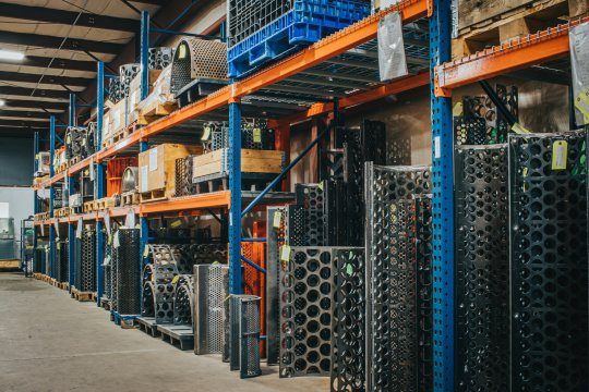 new wear parts stacked in a warehouse