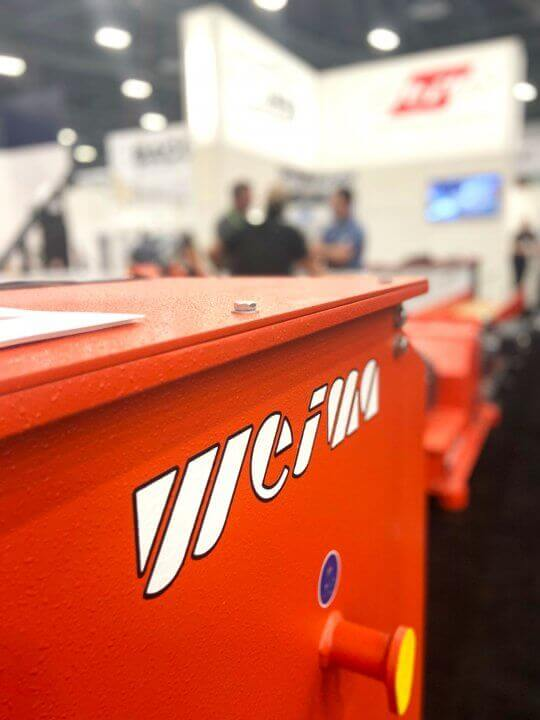A shredder is shown within the WEIMA booth at AWFS Fair 2021.